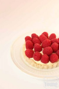 Raspberry tart recipe featured by top US food blog, Among the Young