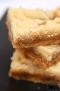 Almond Roca by popular Utah lifestyle blog, Among the Young: image of salted caramel ooey gooey bars.