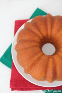 The Best Egg Nog Pound Cake featured by top Utah Foodie blog, Among the Young: image of cake from above | Egg Nog Pie by popular Utah lifestyle blog, Among the Young: image of a egg nog pound cake.