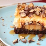 Goo Goo Cluster Brownie Cheesecake