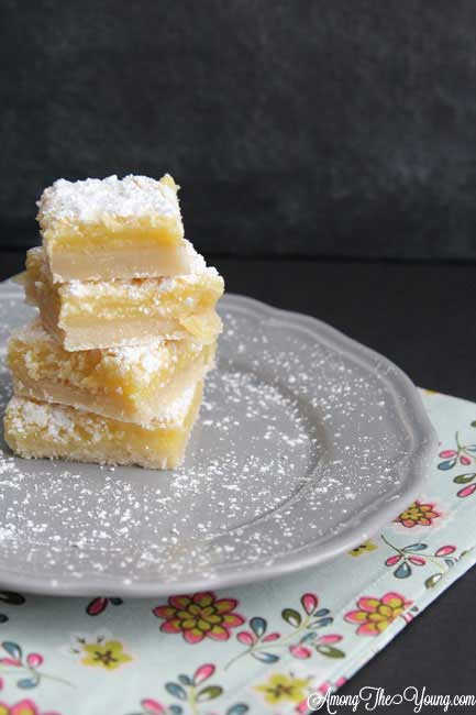 The Best Lemon Bars Recipe in the World, featured by top US food blog, Among the Young: image of powdered sugar on Lemon Bars