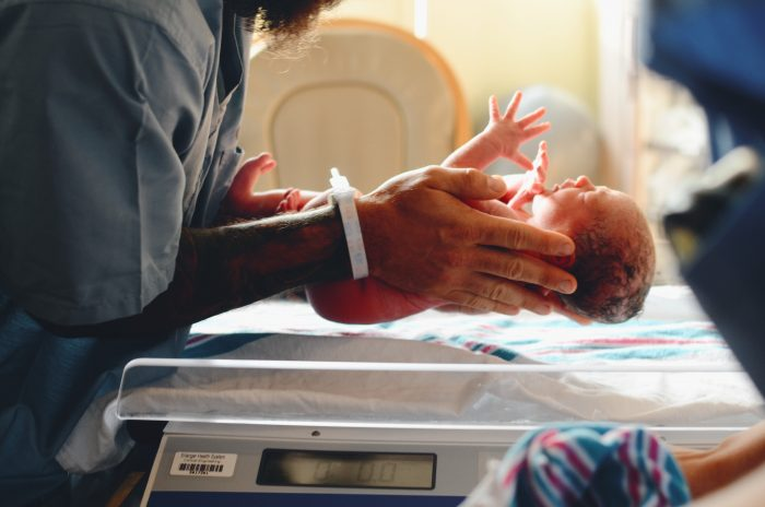10 things to do in the hospital after baby featured by top Utah Lifestyle blog, Among the Young: image of baby on scale