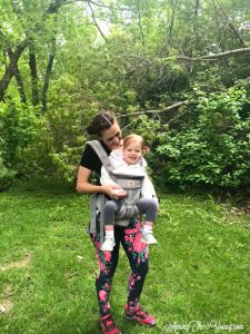 mom wears toddler in Ergo Baby carrier