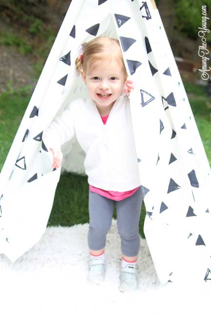 Hiking with an Ergo Baby Carrier featured by top US lifestyle blog, Among the Young: Hike with Toddler playing in a tee pee