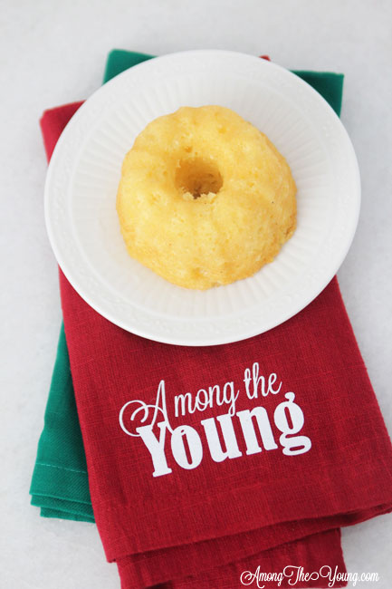 The Best Egg Nog cake recipe featured by top Utah Foodie blog, Among the Young: image of egg nog mini bundt and napkin
