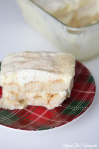 The Best Egg Nog Tiramisu featured by top Utah Foodie blog, Among the Young: image of piece of tiramisu | Egg Nog Pie by popular Utah lifestyle blog, Among the Young: image of a egg tiramisu.
