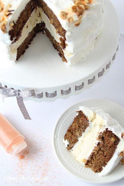 Carrot cake cheesecake cake featured by top Utah Foodie blog, Among the Young: image of Cake and slice of cake | The Ultimate Carrot Cake Cheesecake Cake Recipe by popular US food blog, Among the Youngs: image of carrot cake cheesecake.