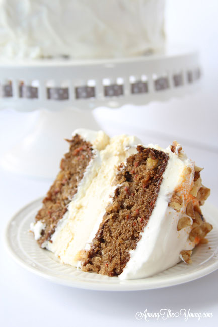 Carrot cake cheesecake cake featured by top Utah Foodie blog, Among the Young: image of sliced cake | The Ultimate Carrot Cake Cheesecake Cake Recipe by popular US food blog, Among the Youngs: image of carrot cake cheesecake.
