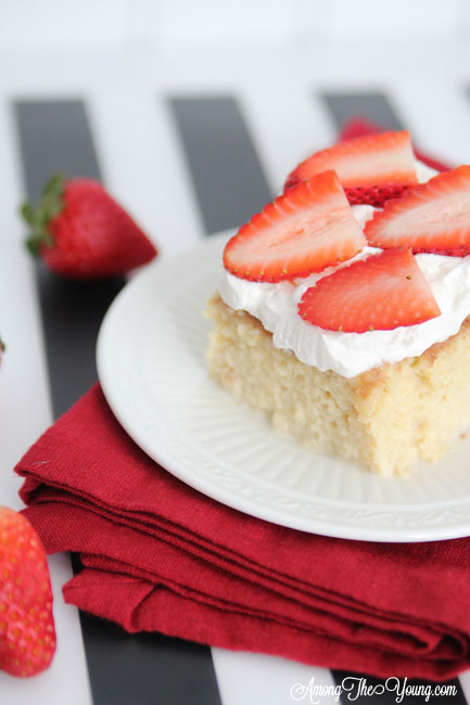 The most delicious tres leches cake featured by top Utah Foodie blog, Among the Young: image of cake and berries | Easy Tres Leches Recipe by popular Utah lifestyle blog, Among the Young: Pinterest image of Tres Leches cake.