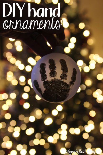 The cutest DIY handprint ornament featured by top Utah craft blog, Among the Young: image of dark ornament PIN | How to make the cutest DIY handprint ornament by popular Utah life and style blog, Among the Young: image of a DIY handprint ornament.