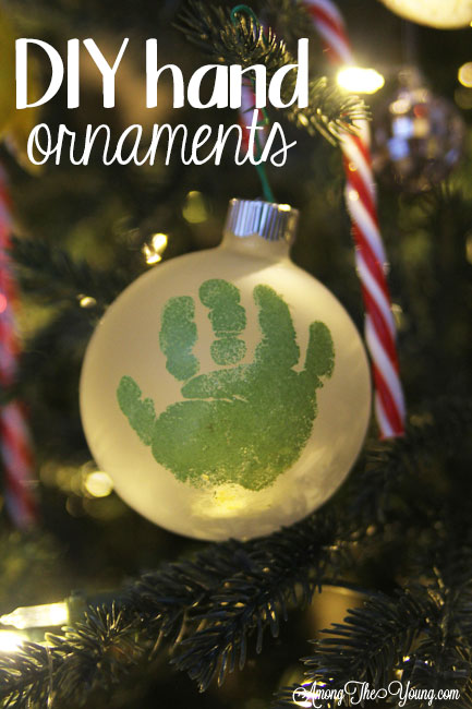 The cutest DIY handprint ornament featured by top Utah craft blog, Among the Young: image of green handprint ornament in tree PIN | How to make the cutest DIY handprint ornament by popular Utah life and style blog, Among the Young: image of a DIY handprint ornament.