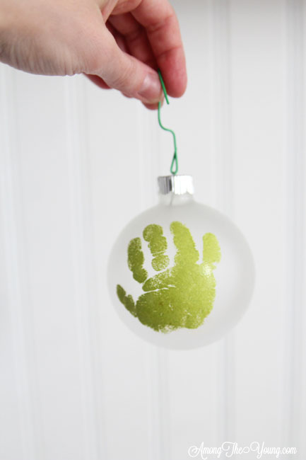 The cutest DIY handprint ornament featured by top Utah craft blog, Among the Young: image of green handprint ornament | How to make the cutest DIY handprint ornament by popular Utah life and style blog, Among the Young: image of a DIY handprint ornament.