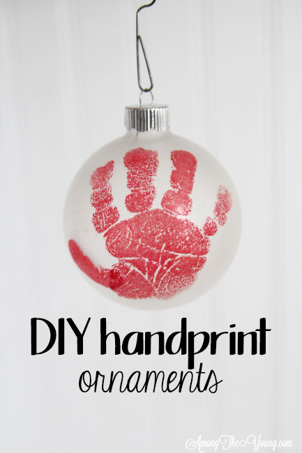 The cutest DIY handprint ornament featured by top Utah craft blog, Among the Young: image of red hand PIN | How to make the cutest DIY handprint ornament by popular Utah life and style blog, Among the Young: image of a DIY handprint ornament.