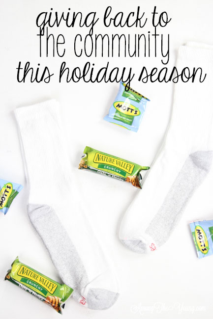 How to give back to the community this Christmas season featured by top Utah lifestyle blog, Among the Young: image of socks and granola bar PIN