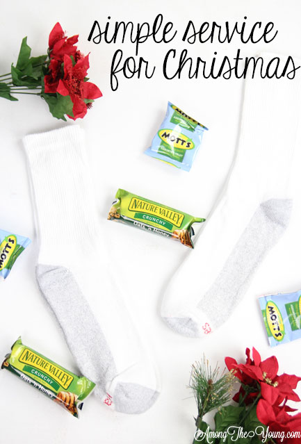 How to give back to the community this Christmas season featured by top Utah lifestyle blog, Among the Young: image of socks PIN |Give Back by popular Utah lifestyle blog, Among the Young: Pinterest image of a socks, granola bars, and fruit snacks.