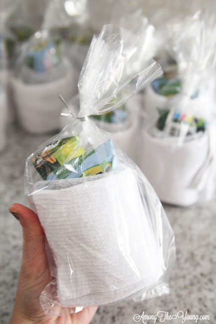 How to give back to the community this Christmas season featured by top Utah lifestyle blog, Among the Young: image of socks rolled up with a granola bar |Give Back by popular Utah lifestyle blog, Among the Young: image of rolled up socks with a granola bar and fruit snacks.