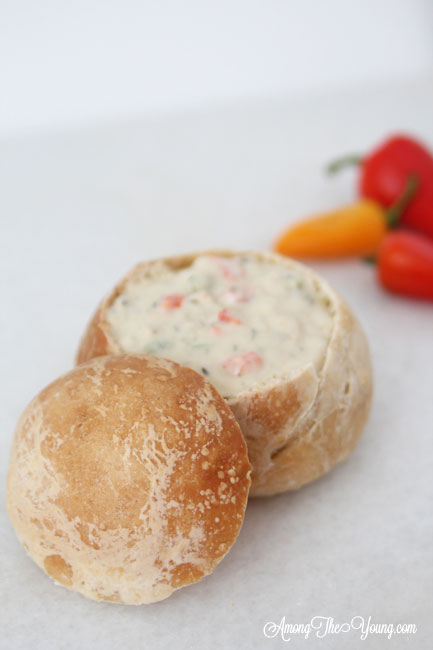 The best Disneyland Clam chowder recipe featured by top Utah Foodie blog, Among the Young: image of clam chowder peppers in background | Copycat Recipes: Disneyland Clam Chowder Recipe by popular Utah food blog, Among the Young: image of copycat Disneyland clam chowder in a bread bowl.