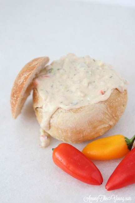 The best Disneyland Clam chowder recipe featured by top Utah Foodie blog, Among the Young: image of clam chowder recipe white background | Copycat Recipes: Disneyland Clam Chowder Recipe by popular Utah food blog, Among the Young: image of copycat Disneyland clam chowder in a bread bowl.