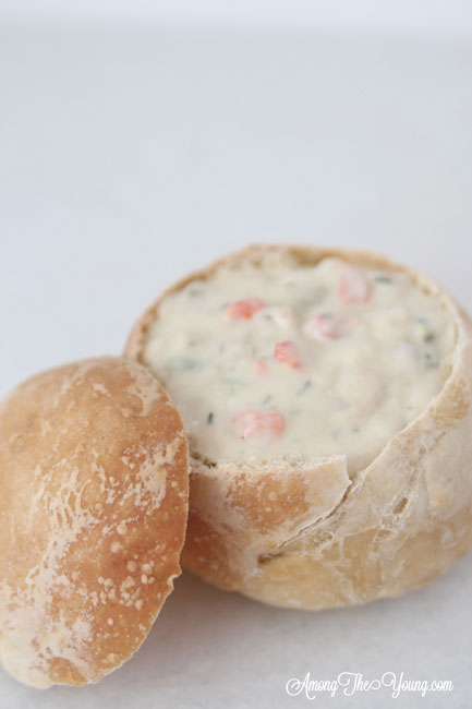 The best Disneyland Clam chowder recipe featured by top Utah Foodie blog, Among the Young: image of clam chowder in bread bowl | Copycat Recipes: Disneyland Clam Chowder Recipe by popular Utah food blog, Among the Young: image of copycat Disneyland clam chowder in a bread bowl.