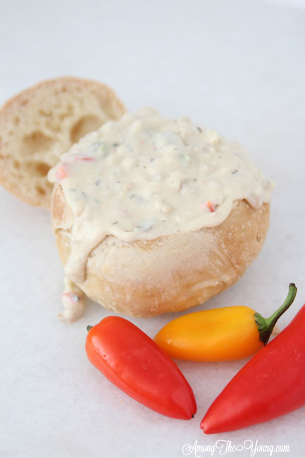 The best Disneyland Clam chowder featured by top Utah Foodie blog, Among the Young: image of clam chowder with peppers | Copycat Recipes: Disneyland Clam Chowder Recipe by popular Utah food blog, Among the Young: image of copycat Disneyland clam chowder in a bread bowl.