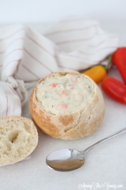 The best Disneyland Clam chowder recipe featured by top Utah Foodie blog, Among the Young: image of clam chowder flat lay close up | Copycat Recipes: Disneyland Clam Chowder Recipe by popular Utah food blog, Among the Young: image of copycat Disneyland clam chowder in a bread bowl.