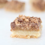 The Best Almond Roca Cookie bars featured by top Utah Foodie blog, Among the Young: image of Almond Roca Cookie bar in focus