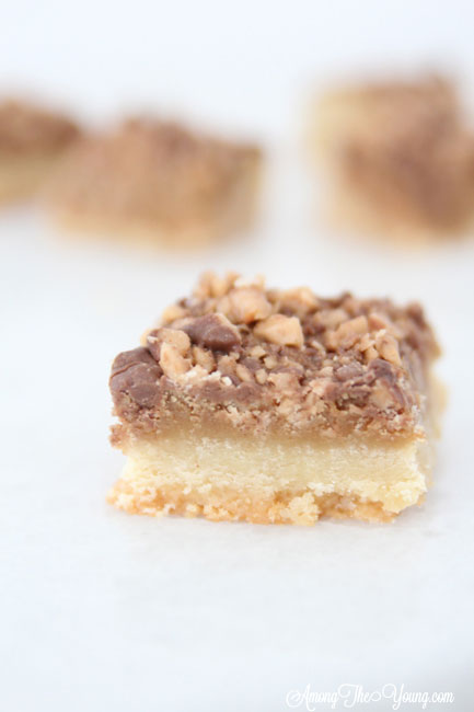 The Best Almond Roca Cookie bars featured by top Utah Foodie blog, Among the Young: image of Almond Roca Cookie bar in focus | Almond Roca by popular Utah lifestyle blog, Among the Young: image of Almond Roca cookie bars.