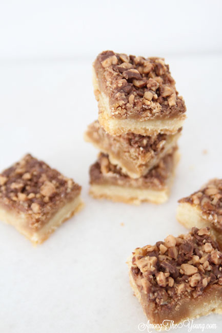 The Best Almond Roca Cookie bars featured by top Utah Foodie blog, Among the Young: image Almond Roca Cookie bars from above and around | Almond Roca by popular Utah lifestyle blog, Among the Young: image of Almond Roca cookie bars.