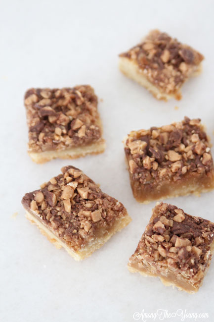 The Best Almond Roca Cookie bars featured by top Utah Foodie blog, Among the Young: image of Almond Roca Cookie bars spread out | Almond Roca by popular Utah lifestyle blog, Among the Young: image of Almond Roca cookie bars.