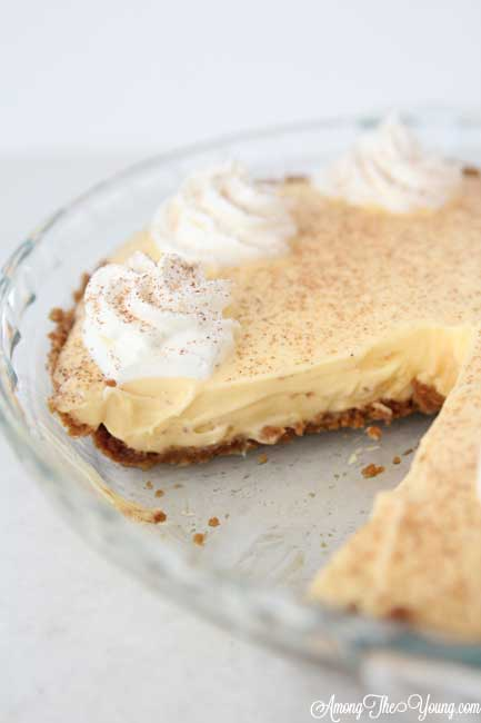 The Best Egg Nog Pie recipe featured by top Utah Foodie blog, Among the Young: image of Egg Nog Pie with Slice left out | Egg Nog Pie by popular Utah lifestyle blog, Among the Young: image of a egg nog pie.
