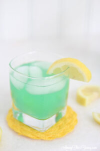 "alt=""The best Disneyland Mint Julep copycat recipe featured by top Utah Foodie blog, Among the Young: image of one mint julep with a lemon"