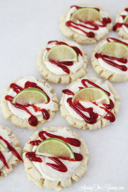 The most amazing raspberry lime sugar cookies featured by top Utah Foodie blog Among the Young: image of cookies placed diagonally | Key Lime Raspberry Sugar Cookies by popular Utah food blog, Among the Young: image of key lime raspberry sugar cookies.