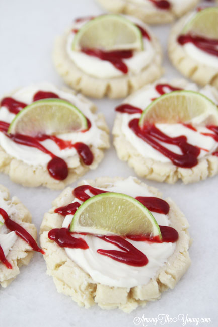 The most amazing raspberry lime sugar cookies featured by top Utah Foodie blog Among the Young: image of close up diagonal cookies | Key Lime Raspberry Sugar Cookies by popular Utah food blog, Among the Young: image of key lime raspberry sugar cookies.