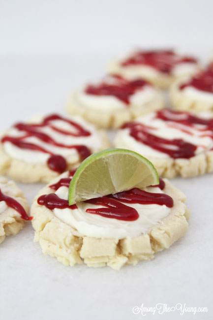 The most amazing raspberry lime sugar cookies featured by top Utah Foodie blog Among the Young: image of cookies in a diagonal line | Key Lime Raspberry Sugar Cookies by popular Utah food blog, Among the Young: image of key lime raspberry sugar cookies.