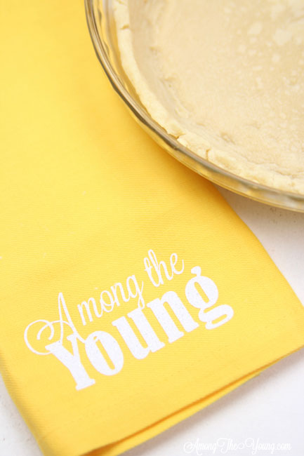 vodka pie crust recipe by top Utah Foodie Among the Young: image of yellow napkin |Vodka Pie Crust Recipe by popular Utah lifestyle blog, Among the Young: image of a vodka pie crust next to a yellow Among the young tea towel.