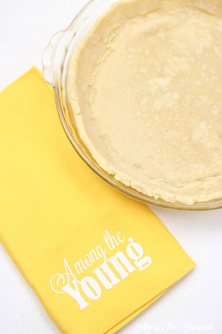 vodka pie crust recipe by top Utah Foodie Among the Young: image of pie with yellow napkin ATY |Vodka Pie Crust Recipe by popular Utah lifestyle blog, Among the Young: image of a vodka pie crust next to a yellow Among the young tea towel.