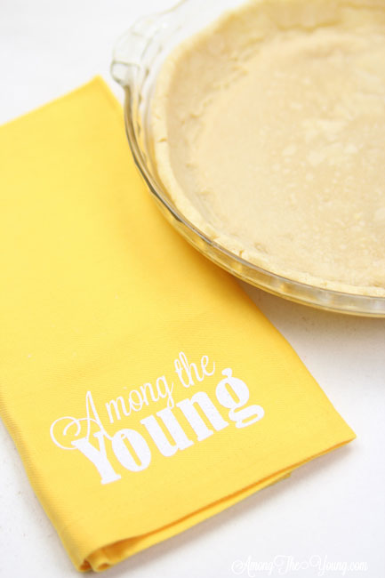 vodka pie crust recipe by top Utah Foodie Among the Young: image of yellow napkin and pie |Vodka Pie Crust Recipe by popular Utah lifestyle blog, Among the Young: image of a vodka pie crust next to a yellow Among the young tea towel.