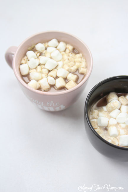 Hot chocolate recipe by top Utah Foodie Among the Young: image of two hot chocolate mugs |Hot Chocolate Recipe by popular Utah lifestyle blog, Among the Young: image of two mugs of hot chocolate.