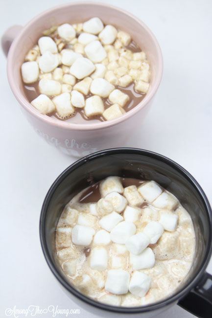 Hot chocolate recipe by top Utah Foodie Among the Young: image of two hot cocoa mugs up close |Hot Chocolate Recipe by popular Utah lifestyle blog, Among the Young: image of two mugs of hot chocolate.