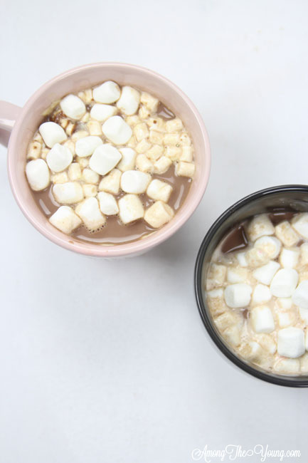 Hot chocolate recipe by top Utah Foodie Among the Young: image of two cocoa mugs and mallows |Hot Chocolate Recipe by popular Utah lifestyle blog, Among the Young: image of two mugs of hot chocolate.