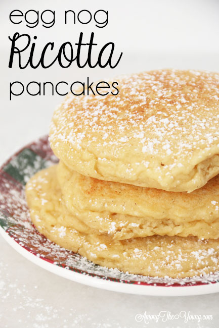 The best ricotta pancakes recipe featured by top Utah Foodie Among the Young: image of pancakes stacked pin |Ricotta Pancakes by popular Utah lifestyle blog, Among the Young: Pinterest image of egg nog ricotta pancakes.