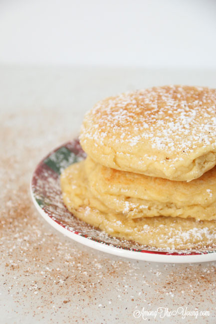 The best ricotta pancakes recipe featured by top Utah Foodie Among the Young: image of ricotta pancakes stacked |Ricotta Pancakes by popular Utah lifestyle blog, Among the Young: Pinterest image of egg nog ricotta pancakes.