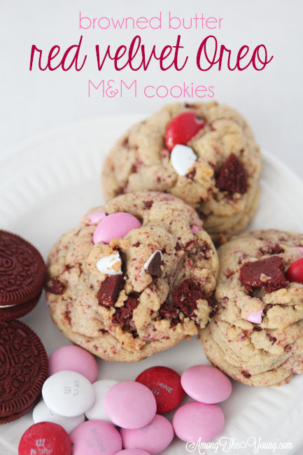 The Best Valentines Cookie featured by top Utah Foodie blog Among the Young: image of red velvet cookies on a plate | Browned Butter Cookies by popular Utah food blog, Among the Young: Pinterest image of browned butter red velvet Oreo M&M cookies.