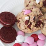 The Best Valentines Cookie featured by top Utah Foodie blog Among the Young: image of cookies, oreos, and M&Ms on a plate