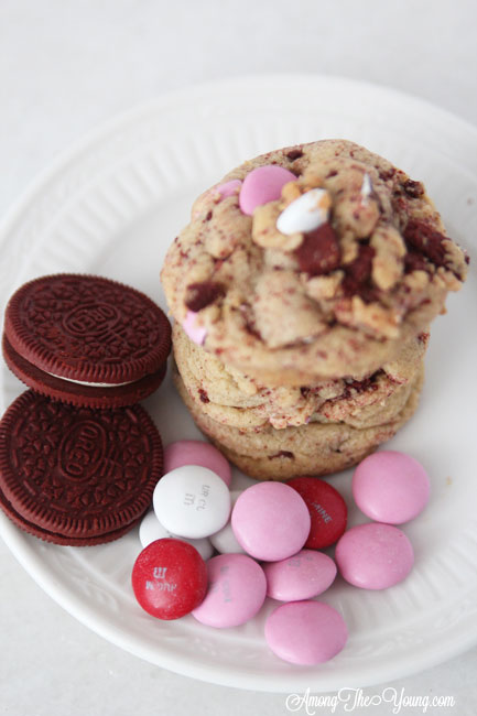 The Best Valentines Cookie featured by top Utah Foodie blog Among the Young: image of red velvet oreo cookies with M&Ms |Browned Butter Cookies by popular Utah food blog, Among the Young: image of browned butter red velvet Oreo M&M cookies.