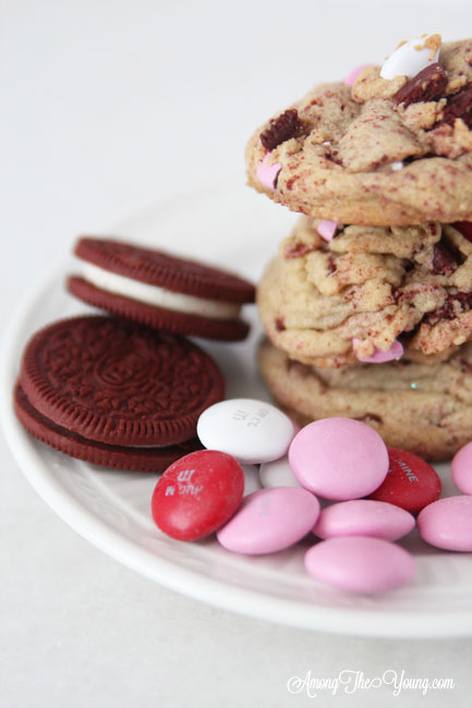 The Best Valentines Cookie featured by top Utah Foodie blog Among the Young: image of Red velvet oreos and M&Ms |Browned Butter Cookies by popular Utah food blog, Among the Young: image of browned butter red velvet Oreo M&M cookies.