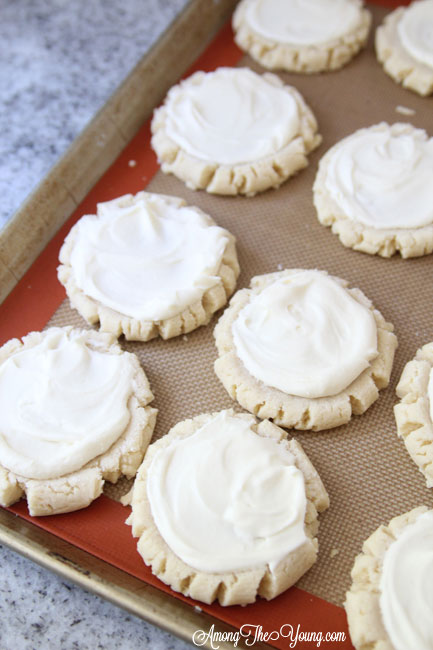 The most amazing raspberry lime sugar cookies featured by top Utah Foodie blog Among the Young: image of unfrosted cookies | Key Lime Raspberry Sugar Cookies by popular Utah food blog, Among the Young: image of key lime raspberry sugar cookies on a baking sheet.