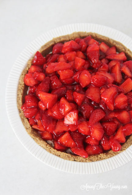 The best strawberry cream pie featured by top Utah Lifestyle blog Among the Young: image of strawberry cream pie repeat pin