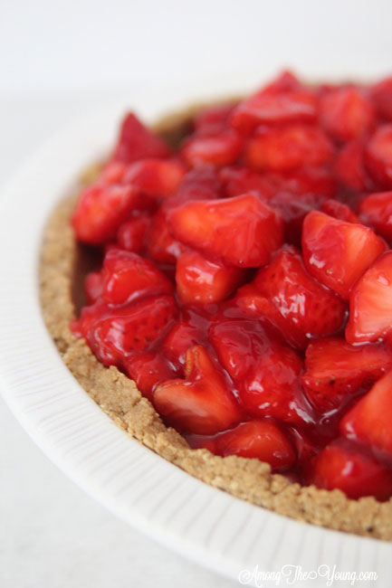 The best strawberry cream pie featured by top Utah Lifestyle blog Among the Young: image of strawberry cream pie close up
