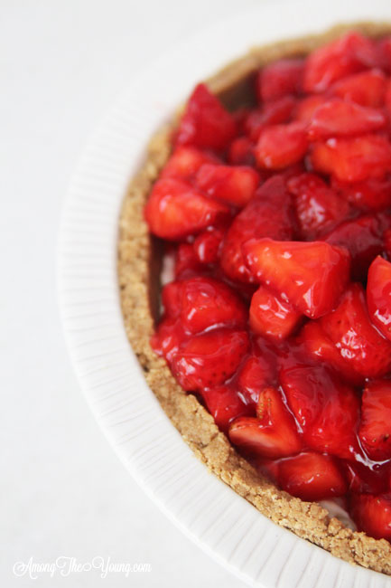 The best strawberry cream pie featured by top Utah Lifestyle blog Among the Young: image of strawberry cream pie side view
